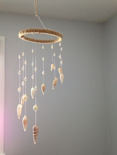 Shell mobile, seashell and pearl mobile, shell and pearl suncatcher, beachy home decor, beach nursery by MaviSellsSeashells on Etsy https://www.etsy.com/listing/223603070/shell-mobile-seashell-and-pearl-mobile