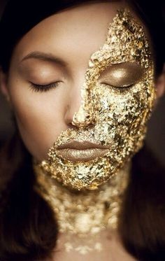 Gold foil, powder your hands so it's easier to handle and use clear gloss to make it stick.