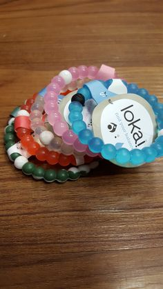 Find your Lokai balance bracelets and give back. The white represents water from Mt. Everest which signifies to stay humble when you are at the highest moment of your life. The black ball represents m
