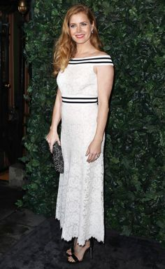 AMY ADAMS in an off-the shoulder lace dress with striped accents, plus Jimmy Choo heels, jewelry by Nirav Modi, Nigaam, and EF Collection at the BAFTA Nominees Party in London.