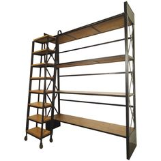 Industrial Wood and Iron Shelving Unit with Sliding Ladder | See more antique and modern Shelves at https://www.1stdibs.com/furniture/storage-case-pieces/shelves