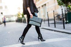 Paris street style: sneakers and sleek minimalism. Erin Conry Webb, designer for Nour Hammour, wears a Nour Hammour jacket, J Brand jeans, Le Parisien vintage handbag, and Zara shoes.