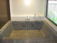 Tiled Roman bath tub