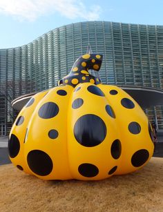 A pumpkin object by Kusama Yayoi, temporarily installed in the garden of a Japanese museum.