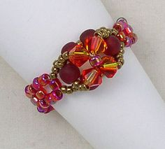 Portia Brilliant red, gold and a hint of orange - Swarovski crystals and matte red Czech Druk beads are accented with tiny gold seed beads. Red beads create the ring band. Beaded Jewelry Designs, Jewelry Patterns, Diy Jewelry, Jewelery, Jewelry Bracelets, Diy Schmuck, Schmuck Design, Wire Wrapped Rings, Homemade Jewelry