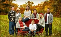 family portrait in a field on a red couch, I like the pose