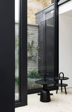 Frame House is a minimal residence located in London, United Kingdom, designed by Bureau de Change. This rear extension and refurbishment to a Victorian terraced house in South London, applies a questioning approach to produce an unconventional arrangement of interlocking geometric glass volumes which reveal a sequence of compelling interior spaces.