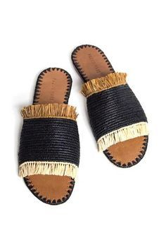 New Raffia Fringe Slide Sandal by Proud Mary. Crocheted woven raffia featuring ivory and brown fringe and contrast side stitching. Handcrafted in Morocco.