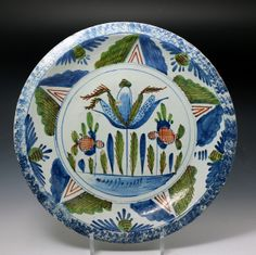 Antique English delftware charger 18th century decorated with a blue sponged bor...