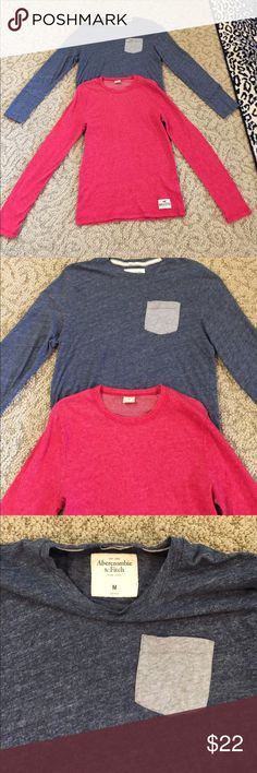HOLLISTER MENS SIZE MEDIUM 2 PACK LONG SLEEVE TEES HOLLISTER MENS SIZE MEDIUM 2 PACK AND ONLY 1 SHIP RATE. RED LONG SLEEVE AND BLUE WITH POCKET LONG SLEEVE Hollister Shirts Tees - Short Sleeve