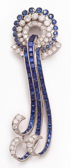 Calibre sapphire and diamond waterfall brooch, set in platinum.    By Paul Flato  American, circa 1935