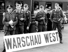 GermanUnteroffiziers and aFeldwebel of the Luftwaffearrive by train to German occupied Poland and pose for a photograph on therailway platformof Warsaw West (Polish: Warszawa Zachodnia). Warsaw, Poland. ca. October 1939.
