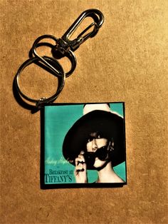 Mini Movie Keychain-Breakfast at Tiffany's! $7 Contact me here or at orifaith1@yahoo.com  to purchase. First time buyers will receive a 10% discount. #breakfastattiffanys #audreyhepburn #georgepeppard #moonriver #hollygolightly
