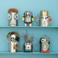 Green craft alert! Recycled cans, big or small... tin or aluminum.... and odds and ends fromt he garage, the junk drawer, wires, old phone cords for hair... nuts and bolts, mason jar rings, pipe anchors, door knobs, old stove parts.... these guys make me smile.... great for Cub Scouts or art projects for boys... great unique decoration for a boys room, or even the nursery if dad likes sci fi!