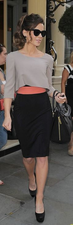 Who made  Kate Beckinsale's black pumps, black handbag, black skirt, and gray long sleeve top that she wore in London?