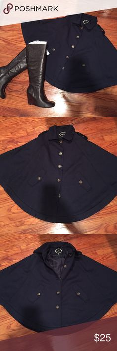 Women's Cape Women's Cape. Navy blue/w brown buttons. Button front W/collar and two front pockets. Gently worn. Great for layering pieces under! (Boots available in separate listing). Love Tree Jackets & Coats Capes