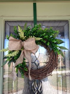 This boxwood wreath has been the bestseller of ValleyDusk so far.  It bears a neutral appeal that makes it ideal as a year round wreath to leave on your front door.  And who wouldn't grin at the cute corner ribbon?  Come see ValleyDusk on Etsy!