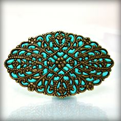 Totally beautiful vintage looking brooch I found in AndreaBacmanJewelry's Etsy store.  There are loads of other pretties there as well!!!