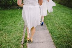 Bridesmaids wear rainbow coloured shoes | Photography by http://www.pnmweddings.com/