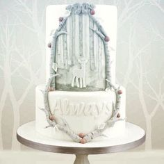 This one is totally elegant while still repping HP love. #refinery29 http://www.refinery29.com/2016/10/126629/harry-potter-wedding-cakes#slide-7