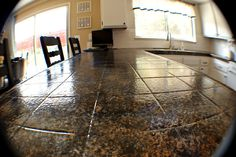tile countertop makeover - including links to product for refinishing tile counters into granite look-alike!
