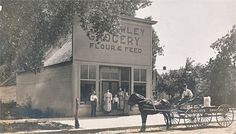 Wm E Hawley Grocery - photo of Wm E. Hawley Grocery store in Hutchinson KS with family on steps