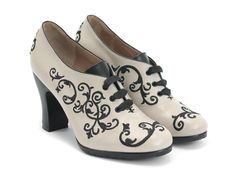 """In appreciation of the truly miraculous gift of sight, John created a beautiful style as a gift to the sense. This gorgeous, embroidered lace-up pump is crafted in Peru with smooth, Peruvian leather and decorated with the same design as The Revelation and The Stunner styles. The Miracles Sight is perched on a 3.5"""" leather wrapped heel, boosting this little piece of visual-excitement to a perfectly placed height for viewing and appreciation. Go ahead and stare."""