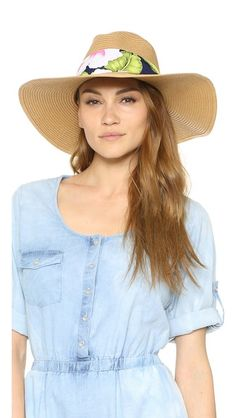 A floral voile sash lends a feminine touch to this western-inspired Eugenia Kim hat. Wide, flexible brim.