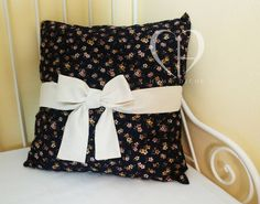 American cotton midnight blue with small flowers in shades of antique pink and ivory and bow in ecru linen Size 45x45