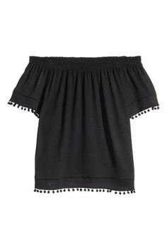 Ribbed jersey skirt: Calf-length skirt in ribbed jersey with concealed elastication at the waist and slits in the sides.