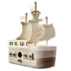 """This unfinished pirate ship wooden birdhouse is ready for painting or staining and decorating anyway your heart desires. It has three sails and a crows nest. The bird's hole measures 1"""" in diameter and there is a perch just below the opening."""