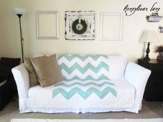 Beautiful tutorial for sewing your own slip cover for your couch! (This couch was red before.) Love the aqua quilt.