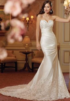 Sophai Tolli a-line gown with asymmetric waist and corset, including beaded and lace embellishments I Style: Y11414 I https://www.theknot.com/fashion/y11414-sophia-tolli-wedding-dress?utm_source=pinterest.com&utm_medium=social&utm_content=june2016&utm_campaign=beauty-fashion&utm_simplereach=?sr_share=pinterest
