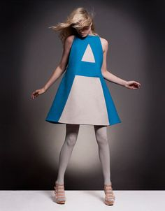 "White dress with the letter ""A"" printed in blue + white tights and high heel sandals"