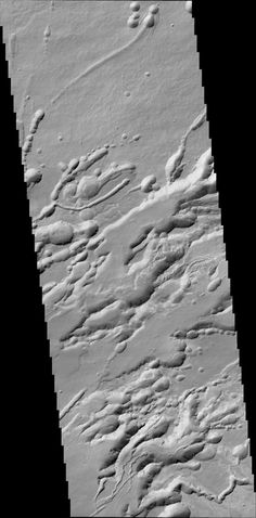 structure called Arsia Chasmata on the flanks of one of the large Martian volcanoes, Arsia Mons. This view was created by the Colour and Stereo Surface Imaging System (CaSSIS) aboard the European Space Agency's ExoMars Trace Gas Orbiter. The width of the image is around 16 miles (25 kilometers). The formation is volcanic in origin, and pit craters are visible.