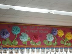 Cute garden theme classroom.  I love the flowers made out of tissue paper.