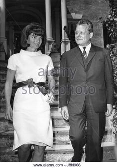 Former first lady Jacqueline Bouvier Kennedy, left, walks West Berlin Mayor Wily Brandt, right, to his waiting car in front of her Georgetown home in Washington, DC on May 19, 1964. Mayor Brandt took time out from his schedule to pay a courtesy call on Mrs. Kennedy. Credit: Benjamin E. 'Gene' Forte/CNP /MediaPunch - Stock Image