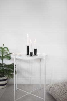White Ikea Gladom table with Menu candles