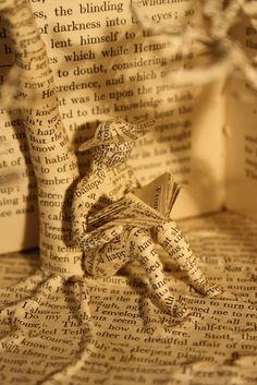 Within a book....    More book paper sculptures:  http://www.visualnews.com/2013/03/02/paper-sculptures-from-within-a-book/