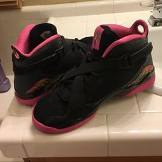 Air Jordan 8 Black and pink air Jordan 8! Worn only a couple times. They are still in great condition. Size is 6.5 but I'm a 7.5 and these fit just fine. They run a bit bigger. Comes with box! Jordan Shoes Sneakers