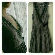 NWOT/Free People/Faux Wrap/Jumper/Sleeveless New List/Free People/Great condition! Silk Faux wrap/Very cool purple color/black trim accents/Flowy and light but with the cool rocker tie. Size 4. I think would fit a size two even better, you can bundle this for a discount!! Purchased from another closet holder/just never wore it/if you don't wear/you share/or in my case/re-list hoping someone will love it and wear it. Checked it over is in very excellent condition/Has a faux wrap look/add a…