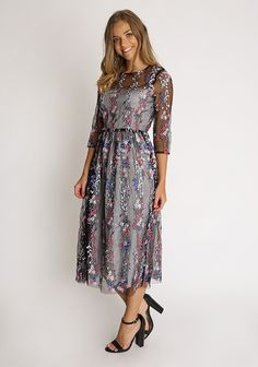 Black embroidered fit and flare midi dress in tulle fabric with round neckline, 3/4 sleeves and hidden back closure. Partially lined, semi sheer yoke and sleeves.