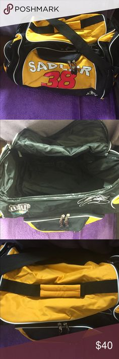 NASCAR #38 large gym/travel bag NASCAR Elliott Sadler #38 m&m's racing team large gym/travel bag. Side zipper pockets. 2 front zipper pockets. Handle on top and adjustable straps. Perfect condition. Vinyl front and back, canvas bottom. Inside zipper pocket. Bags Travel Bags