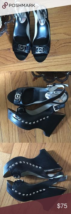 Michael Kors Studded WedgesWEEKEND PRICE DROP ONLY Black with silver studs and the sliver MK on toe box. Worn a couple of times. 4 1/2 inches Michael Kors Shoes Wedges
