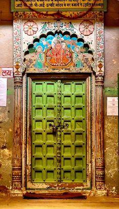 Door in Varanasi, Uttar Pradesh, India | Photograph by Roberto Manfredi