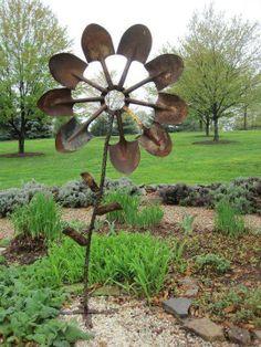 Garden art: Rusty flower out of shovels... love this!