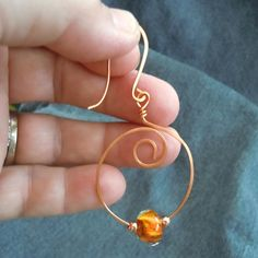 copper hoop earring with lampwork bead