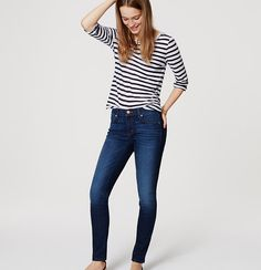 """Expertly designed with premium mills to smooth, lift, fit and flatter in all the right places, our denim is so soft and stretchy you'll never want to take it off – and only gets better, wear after wear. In a dark indigo wash, our skinny jeans are our highest rise with a slim, streamlined fit from hip to hem. Your perfect fit if your hips are proportionate to your waist. Front zip with button closure. Belt loops. Belt loops. Contrast topstitching. Signature hardware. 25"""" inseam."""