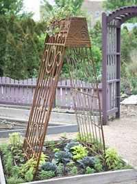 Make a Vintage Trellis - Old Garden Gates. I don't have old gates but I do have two elongated tins left over from Xmas that I could easily attach with dowels or garden stakes. Old Garden Gates, Old Gates, Garden Arbor, Diy Garden, Garden Projects, Garden Landscaping, Garden Ideas, Metal Gates, Iron Gates