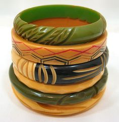Vintage Bakelite bangles - I have one from my Canadian Great-Aunt.  It is in the yellow color - larger and with similar incising to the top green one.  Love it and just started to wear it.